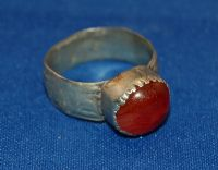 A large 18th/19th Century pleasant Islamic silver gents finger ring with a Carnelian gemstone set bezel. SOLD